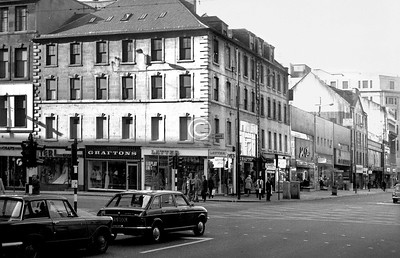 Stockwell St and Argyle St. There was much building around here in the latter decades of the 18th century, unplanned but harmonious, of handsome Georgian four-storey tenements, and this corner block, its neighbour, and the one further down Argyle St were among the few that remained. They didn't survive much longer though.    October 1973