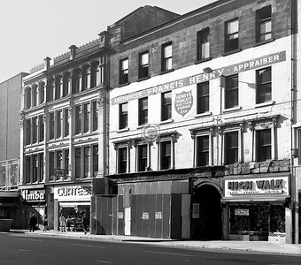 North side of the Trongate, opposite the New Wynd. The further, Italianate building survives, but not the nearer tenement of c1800.    August 1973