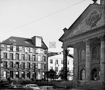 St Andrew's Square. Laid out in 1768, this was the first of Glasgow's squares - St Enoch's followed in 1782 and George in 1787. The white painted building was one of the few remaining original houses, and now seems to have been replaced. The taller block has been handsomely restored, with that nightmarish lift shaft removed.  October 1973