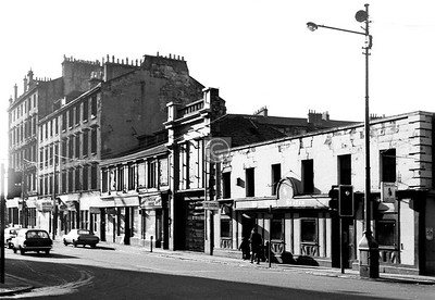 Stockwell St, west side south of the Bridgegate. Next to the Old Scotia is the former Metropole Theatre. It started in 1862 as the Scotia Theatre (Stan Laurel's father was the manager in the early days), changed its name in 1897, and was gutted by fire in 1961.    November 1973