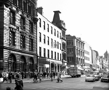 Trongate, north side east of Glassford St.     The plain building next to the Royal Bank is worth noting, for it was Spreull's Land, and had a curious origin. The previous house on the site, which had adjoined the original Hutchesons' Hospital,  belonged to   Margaret Spreull, born in 1700, the daughter of John Spreull, a man of affairs better remembered as Bass John from the years he spent imprisoned on the Bass Rock, having backed the Covenanters at Bothwell Bridge. Margaret, a spinster and the last of her line, wishing to perpetuate the family name bequeathed the house to her nephew James Shortridge, with an entail stipulating that if he wished to inherit he must change his name to Spreull. This he did on her death in 1784, and he immediately pulled down the old house and erected the fine building which became known as Spreull's Land. A letting concern, as James already had a villa at Linthouse, it commanded a good rent and was for half a century one of the smartest addresses in town.  October 1973