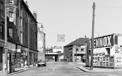 Old Rutherglen Rd, looking west from Crown St.   Some of Lennox's prices: Margarine 6½p / Tea biscuits 3p / Sugar 7½p for 2lb / Condensed milk 8½p.    April 1973