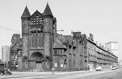 Cathcart Rd and Crown St.   W.G.Rowan's fine neo-Romanesque St Ninian's Wynd Church stood, a dark red sandstone half-kirk half-fortress, guarding the eastern south entry to the Gorbals. Built in 1888 as the Wynd U F Church, it united with St Ninian's Parish Church after the reconciliation between the Free and Established Churches.    April 1973