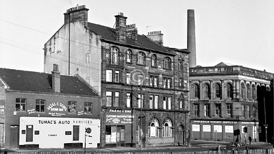 Gorbals St, west side at Bedford Lane.   The buildings are 1, a small warehouse of c1907 which was distinguished by a pair of cast-iron grotesque faces at first-floor level (wish I had thought to photograph them); 2,  the splendid art nouveau British Linen Bank building (James Salmon jnr, 1900); 3, Gorbals Public Baths and Washhouse (John Carrick, 1885), to which the chimney belonged. All three survived for  several years after the rest of Gorbals St had been redeveloped, but now only the Bank building remains, derelict and with an uncertain future.    October 1973