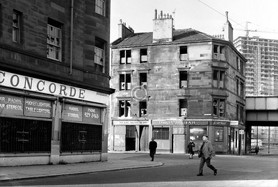 Old Rutherglen Rd at Hospital St.    Pearl Bloch, grocer and baker, next to James McKell's Turf Bar - this had a real touch of the old Gorbals about it, but its destruction was all too imminent.    December 1975