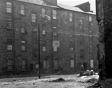 Maxwelton's braes are bonny, whaur early fa's the dew . . . . The last of the back-court singers, behind the tenements on the west side of Crown St. April 1973