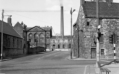 McLeod St. from Castle St.  The buildings at the far end, in Collins St, were the Collins Institute and the Townhead Baths and steamie, to which the  chimney belonged.  April 1973