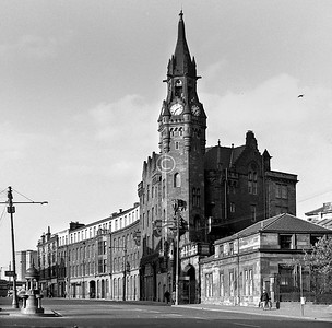 Castle St., east side, north of Cathedral St.    This baronial fantasy was built as the Royal Blind Asylum in 1881. The Royal Infirmary later took it over and built the plainer northern extension, which has now been replaced by a multi-storey car park, though the Asylum building is still there.   July 1973