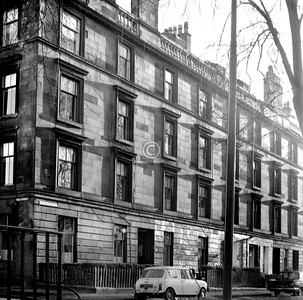 Greenhead St, south of Mill St.    Greenhead St had an air of  Bridgeton's West End about it, and up to Mill St it has survived pretty well, but the rest  is new housing and vacant land.    January 1976