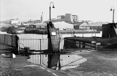 Where the Govan Ferry used to ply to and from, at the foot of Water Row. The ferry was withdrawn in January 1966, after the opening of the Clyde Tunnel, though it enjoyed a temporary revival in 1978-9 when the subway system was closed for renovation.   February 1974