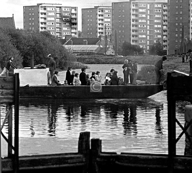 Above the top lock (the locks were all out of action by this time). An early Canal Festival , I think. Wyndford high flats with some smoke damage. 