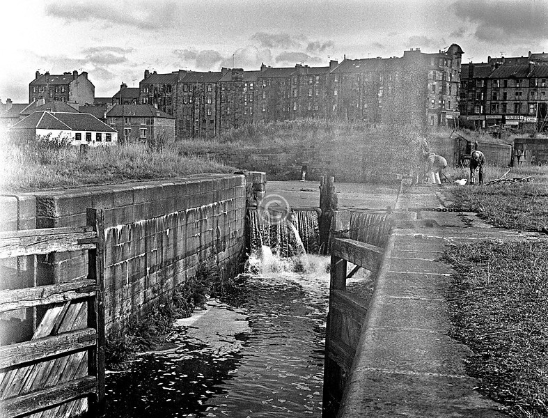 Lowest of the Maryhill locks on the F&C.   This camera, a Russian roll-film, developed a light leak, easily fixed with insulating tape but not before it had spoiled a few shots. However these tenements on Maryhill Rd are long gone so I thought this worth including.   June 1976