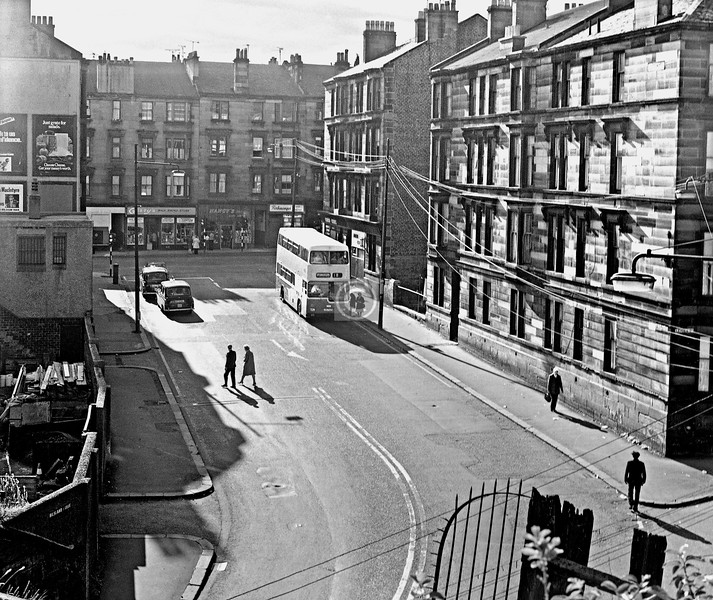 Bilsland Dr at Maryhill Rd, from the aqueduct.  Bilsland Dr. hasn't changed much, but the tenements in Maryhill Rd were cleared to open up a new entry to Queen Margaret Dr  October  1975