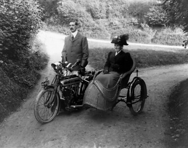Grandpa, Robert H Bisco with his Mother. note a sidecar has been added to the AJS