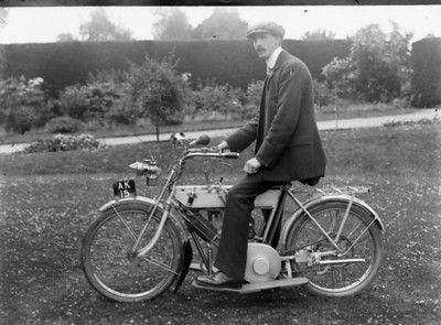 Robert Bisco with his trusty steed. he was the first person in Newent to own a Motorcycle.