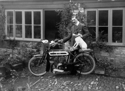 Robert Bisco with another motorcycle a bigger capacity V Twin A.J.S. + dog!