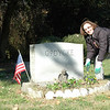 Susan Opdycke is planting flowers on her son's grave. He was 4 years old when he died 20 years ago. Susan always replaces the flowers on Holiday's.