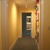 hallway with built ins looking towards master