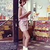 HARVEY (IL) CAMERA SHOP  1960's<br /> The owner was testing a camera and asked Gloria for a moment.