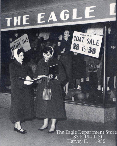 EAGLE DEPT. STORE - HARVEY, IL - 1955<br /> Thornton high school students looking at their yearbooks.<br /> (From the Thorntonite yearbook, 1955)