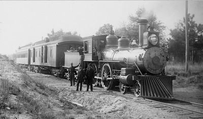 Jacksonville, Tampa, & Key West railway 4-4-0 engine number 4 is shown ca. 1885. The locomotive later served Henry Plant's South Florida railroad and then the ACL as 563. The Jacksonville, Tampa, & Key West railway, which held a state charter to build a railroad to Tampa, was absorbed into the Plant System, and Plant's South Florida railroad connected the first rail line from Plant City to the Tampa Bay area in 1883-84. Courtesy State Archives Collection