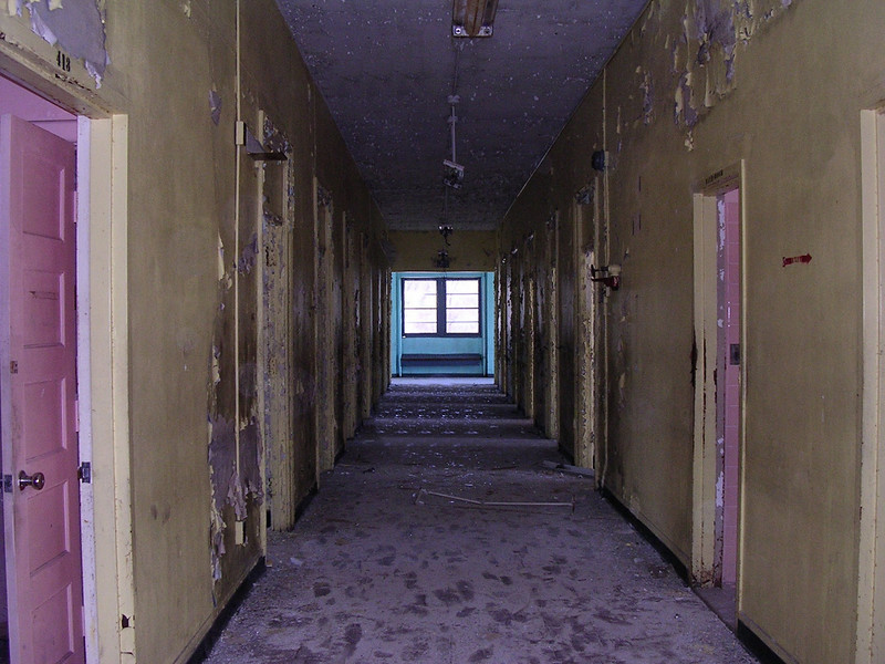 A corridor on the second floor lined with patients' rooms. All the walls were painted in bright yellow, light blue, pink, or turquoise. Each room was a different color. <br /> <br /> 4-23-07