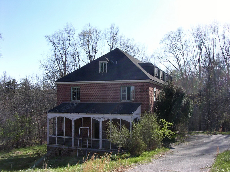This was the physicians' and nurses' cottage when the center was a TB sanatorium. At some point it was broken up into small apartments, probably when the complex was converted to an institution for retarded adults and onsite medical personnel were no longer needed.  <br /> <br /> UPDATE: In April of 2011 the roof of this building was destroyed by a fire. The origin of the fire is uncertain, but it is believed to have been a lightning strike rather than vandalism.<br /> <br /> 4-23-07