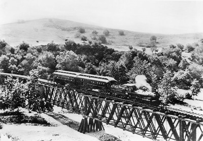Los Angeles and San Gabriel Railroad train on the bridge at Garvanza, the first trestle across the Arroyo Seco, approaching Highland Park from South Pasadena, ca.1885