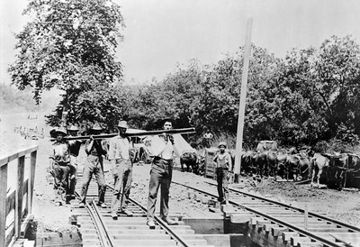 Workers laying the last rails of the San Gabriel Railroad, Highland Park, Los Angeles, 1885