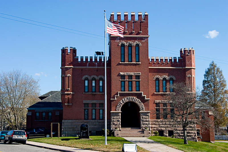 <center>Westerly Armory<br>Westerly, Rhode Island<br>The Westerly Armory was built in 1902 on the corner of Railroad and Dixon Streets in Westerly, Rhode Island. In 1908 the Coast Artillery Corps of the Rhode Island National Guard was formed. The Corps served in World War I but was mustered out at the War's conclusion.</center>