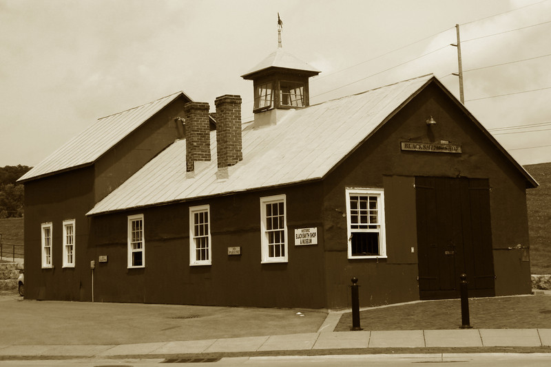 <i>Richardson's Blacksmith Shop (ca. 1897)</i> - Galena was at one time home to some 34 blacksmith shops.  Today only this one remains.  The shop operated from its construction until 1979.  It is now open for tours.