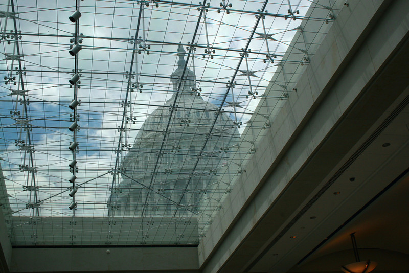The dome of the Capitol rises above the skylights of the visitors center