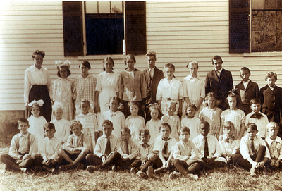 School House #8 This picture is circa 1918. Located on Bartley Hill Road, this schoolhouse replaced the old 25-foot by 17-foot red schoolhouse that was built in 1794. The newer building was finished in 1858 and the belfry was added 1912. The building burned down in 1931 but was replaced in 1932. It also served multiple purposes to the community, providing a place to host events like singing school, spelling competitions, and religious revivals.