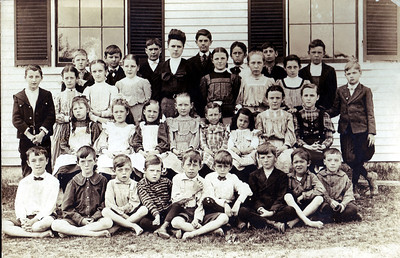 School House #7 This image is circa 1906. This school house is located on Grenier Field Road (originally called Goffe's Falls Road), located near White's Tavern. It served eight grades of grammar school scholars in North Londonderry. Girls entered and exited through the left door of the school and boys used the right door. There was probably only one teacher for a large number of students. It still stands today, but is now a private residence.