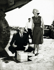 Alan Shepard and wife under a truck ready to blast ledge on the I93 project