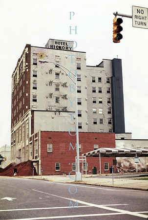 Hotel HIckory Demolition - Implosion 1973.  This picture shows the very first charges being set off. Note upper left and lower right as well as the cracks along the window lines.