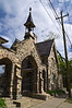 The main gate, built 1874, flanked by two pedestrian gates.  None of the three remains in use.  Instead, all ingress and egress is through a later side gate immediately north of the office (formerly the gatekeeper's house).<br /> <br /> Forest Hill Cemetery, Ann Arbor, Michigan<br /> April 21, 2012