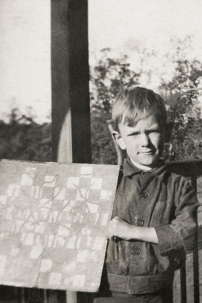 Robbie Stehbens with his hand-made Snakes & Ladders Board, 1922