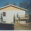 "Ken and a ""siding crew"" worked on The Pines staff house."