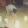 Keith fixing holes in the Dining Room floor.