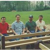 The guys taking a break on their newly made benches.