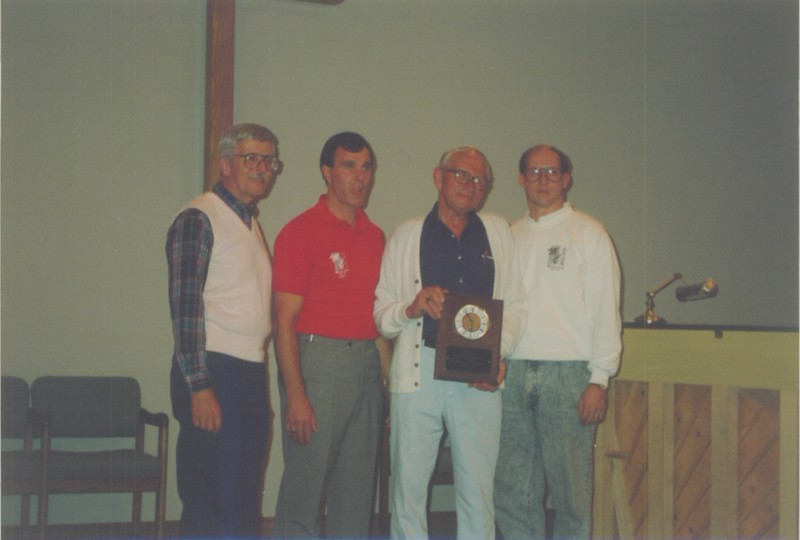 """""""Mr. Camp"""" (Ralph) gets a plaque to recognize his 25 years of service."""