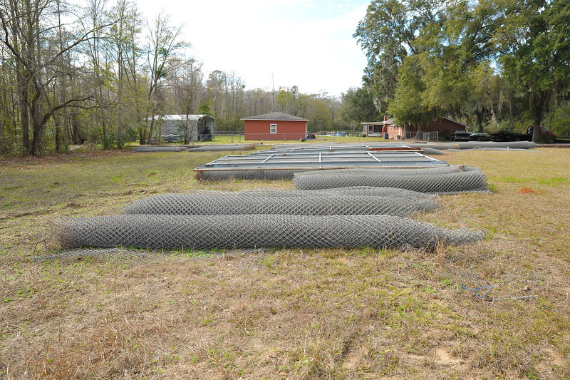 Fencing for sale in Darien, Georgia - Galvanized Chain link (15x50 rolls at $200 each), Galvanized gates, stainless steel mesh 5x50 rolls at $125 each) 02-13-13