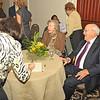 L to R: Alice Nightingale (signing), Joyce Fendig, Albert Fendig (Honoree)