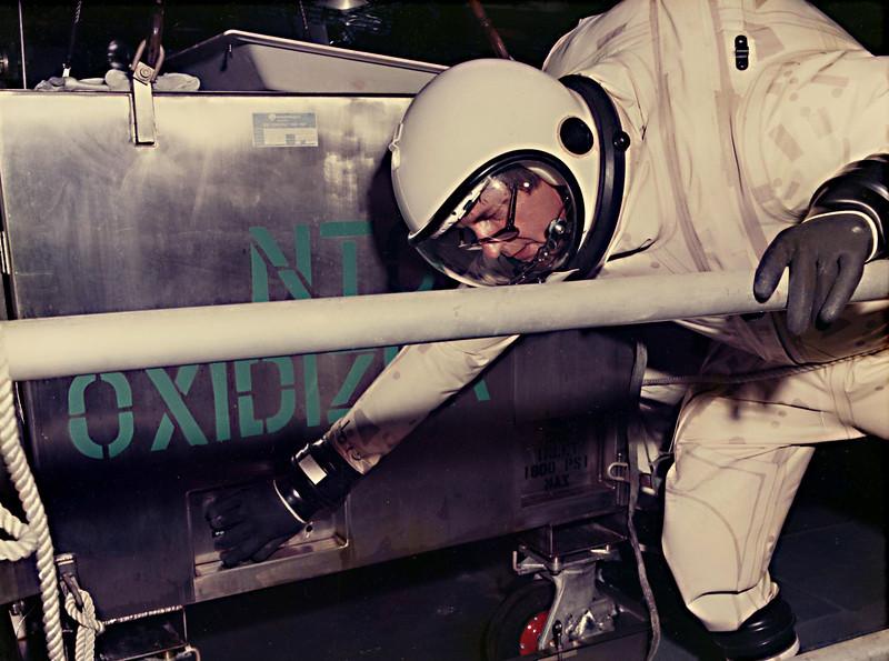 Jess loading 500 pounds of nitrogen tetroxide from this propellant cart into a flight interceptor.