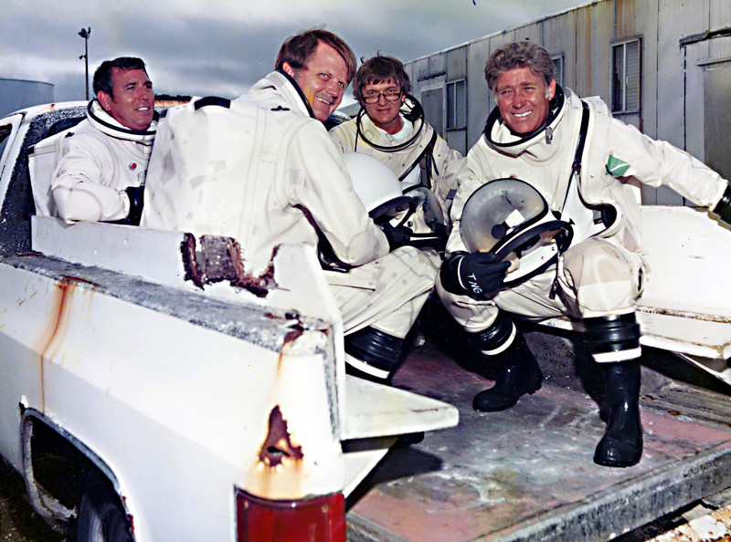 """Four of the eight propellant team members on the way to the access stand to load propellants into the interceptor H&K (homing and kill) vehicle.  Left to right, Hal Barber, Jack McCabe, Jess, and Frank Murray.  Hal and Jess wrote every procedure reqired for tanking, which usually took 12 to 16 hours for each of the two propellants.  Jess was responsible for training the team members, and in the early launches, he and Hal were the primary team members.  The backup (and rescue) crew were Jack and Frank. Jack and Frank were suited up and on liquid air packs at the bottom of the access stand whenever Hal and I were working with live propellants. If there were an accident (what, on my watch???), they had volunteered to climb the four flights of stairs and do all humanly possible to rescue us. To say that I trusted any of my team with my life would be an understatement; I did it repeatedly.  After all, I had trained them.<br /> <br /> Yes, once I had fired a team member just before a live tanking (not one of these).  We always did a """"walkthrough"""" (shorts and t-shirts) before each tanking, touching each valve we would have to operate in the real event.  He kept yawning and couldn't concentrate, and when pressed, admitted that he had been out very late with his girlfriend.  I had to replace him on the spot."""