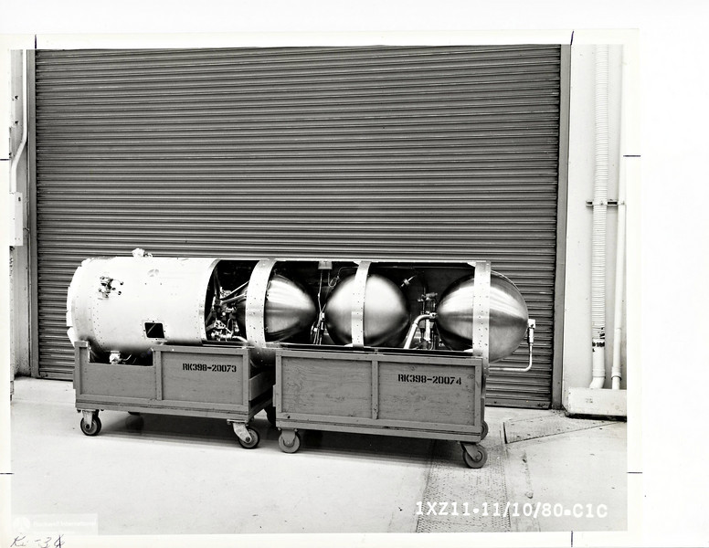 Homing and Kill (H&K) propulsion stage, at Rocketdyne, with covers removed to show tanks inside.  In addition to the two propellant tanks, a third sphere will contain 6,000 psi nitrogen for cold-gas attitude control thrusters.