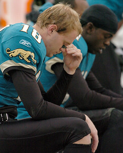BOB SELF/The Times-Union -- 12/11/05 -- Jacksonville Jaguars wide receivers Matt Jones (18) and Reggie Williams (11) sit dejected on the Jaguars bench as the clock ticks down and the Indianapolis Colts win 26-18 Sunday December 11, 2005 at Alltel Stadium in Jacksonville, Fl. (BOB SELF/The Times-Union)