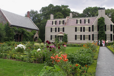 Behind the Old House is the Adams library and an extensive garden.