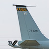 "The ""tail feathers"" of the KANG KC-135E Stratotanker. Prominent in this view are the ""Kansas"" tail banner and the ""Kansas Coyotes"" markings on the flying boom. The black ruddervators are moved by the onboard boom operator who flies the boom down and into the refueling receptacle in the receiver aircraft. Once connected fuel transfer begins."